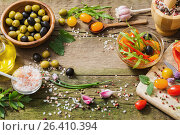 Купить «vegetables and olives on old wooden background», фото № 26410394, снято 29 мая 2017 г. (c) Майя Крученкова / Фотобанк Лори