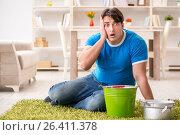 Купить «Man at home dealing with neighbor flood leak», фото № 26411378, снято 24 марта 2017 г. (c) Elnur / Фотобанк Лори