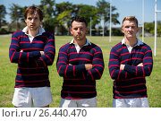 Portrait of confident rugby players standing at sports field. Стоковое фото, агентство Wavebreak Media / Фотобанк Лори
