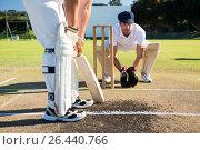 Close up of man batting while playying cricket at field. Стоковое фото, агентство Wavebreak Media / Фотобанк Лори