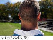 Купить «Close up rear view of rugby player standing at playing field», фото № 26440994, снято 9 февраля 2017 г. (c) Wavebreak Media / Фотобанк Лори