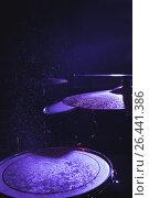 Купить «Wet drum kit in illuminated nightclub», фото № 26441386, снято 7 марта 2017 г. (c) Wavebreak Media / Фотобанк Лори