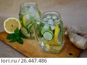 Refreshing drink of cucumber, lemon and ginger. Стоковое фото, фотограф Галина Голубь / Фотобанк Лори