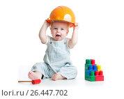 Купить «Baby in hardhat playing toys isolated on a white background.», фото № 26447702, снято 18 декабря 2013 г. (c) Оксана Кузьмина / Фотобанк Лори