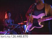 Купить «Male playing guitar with female drummer in nightclub», фото № 26448870, снято 7 марта 2017 г. (c) Wavebreak Media / Фотобанк Лори
