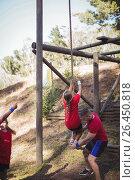 Купить «Trainer instructing a kid in the boot camp», фото № 26450818, снято 16 марта 2017 г. (c) Wavebreak Media / Фотобанк Лори