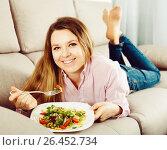 Купить «Woman tasting fresh green salad», фото № 26452734, снято 13 марта 2017 г. (c) Яков Филимонов / Фотобанк Лори