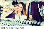 Купить «Female shopper boasting her purchases in underwear shop», фото № 26452770, снято 20 марта 2017 г. (c) Яков Филимонов / Фотобанк Лори