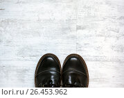 Man in brown shoes standing on the wooden floor background. Стоковое фото, фотограф Dmitriy Melnikov / Фотобанк Лори