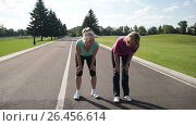 Exhausted female runners resting after jogging. Стоковое видео, видеограф Швец Анастасия / Фотобанк Лори