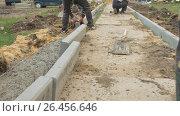 Купить «Mtsensk, Russia 23 May 2017. EDITORIAL- Construction, reconstruction of the pedestrian zone - pavement.», видеоролик № 26456646, снято 19 ноября 2017 г. (c) Константин Мерцалов / Фотобанк Лори