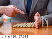 Businessman with dominoes in the office. Стоковое фото, фотограф Elnur / Фотобанк Лори