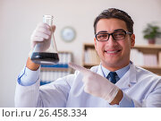 Купить «Young lab assistan working in the laboratory», фото № 26458334, снято 6 января 2017 г. (c) Elnur / Фотобанк Лори