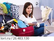 Купить «Woman booking online for holidays at home», фото № 26483130, снято 22 марта 2017 г. (c) Яков Филимонов / Фотобанк Лори