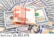 Купить «Folded five thousandths banknotes of russian roubles on the american dollars», фото № 26483478, снято 6 января 2017 г. (c) FotograFF / Фотобанк Лори