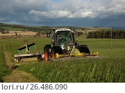 Купить «Mowing second cut grass with front and rear mounted mower conditioners on a Fendt tractor. (Photo by: Wayne Hutchinson/Farm Images/UIG)», фото № 26486090, снято 25 мая 2018 г. (c) age Fotostock / Фотобанк Лори