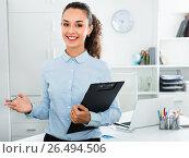Купить «Portrait of businesswoman with clip pad in office», фото № 26494506, снято 9 апреля 2020 г. (c) Яков Филимонов / Фотобанк Лори