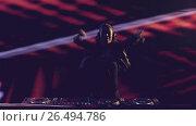 Купить «Young woman with a DJ mixer», видеоролик № 26494786, снято 7 апреля 2020 г. (c) Raev Denis / Фотобанк Лори