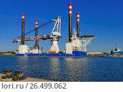 Купить «Wind turbine installation vessel MPI Enterprise in harbour, Germany, Lower Saxony, Bremerhaven», фото № 26499062, снято 10 октября 2015 г. (c) age Fotostock / Фотобанк Лори