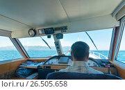 Купить «Рулевая рубка корабля. Капитан ведет теплоход по озеру Байкал», фото № 26505658, снято 18 августа 2011 г. (c) Виктория Катьянова / Фотобанк Лори