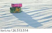 Купить «Christmas gifts in a field on snow in a sunny, frosty and clear weather outdoors», видеоролик № 26513514, снято 9 мая 2017 г. (c) Mikhail Davidovich / Фотобанк Лори