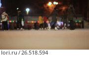 Купить «Moscow. Skating rink in the open air. People skate in the winter. Evening time. Christmas lights.», видеоролик № 26518594, снято 4 апреля 2017 г. (c) Mikhail Davidovich / Фотобанк Лори