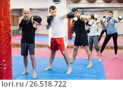 Купить «People of different ages training at kickboxing», фото № 26518722, снято 5 мая 2017 г. (c) Яков Филимонов / Фотобанк Лори