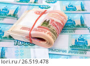 Купить «Folded stack of five thousandths banknotes of russian roubles on money background», фото № 26519478, снято 9 января 2017 г. (c) FotograFF / Фотобанк Лори