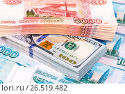 Купить «Stack of five thousandths banknotes of russian roubles and dollar banknotes», фото № 26519482, снято 9 января 2017 г. (c) FotograFF / Фотобанк Лори
