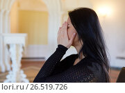 Купить «unhappy crying woman at funeral in church», фото № 26519726, снято 20 марта 2017 г. (c) Syda Productions / Фотобанк Лори