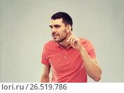 Купить «man having hearing problem listening to something», фото № 26519786, снято 15 января 2016 г. (c) Syda Productions / Фотобанк Лори
