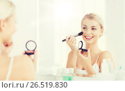 Купить «woman with makeup brush and blush at bathroom», фото № 26519830, снято 13 февраля 2016 г. (c) Syda Productions / Фотобанк Лори