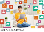 Купить «happy young asian woman with tablet pc at home», фото № 26519922, снято 9 марта 2016 г. (c) Syda Productions / Фотобанк Лори