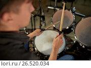 Купить «man playing drums at concert or music studio», фото № 26520034, снято 18 августа 2016 г. (c) Syda Productions / Фотобанк Лори