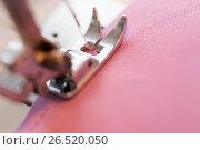 Купить «sewing machine presser foot stitching fabric», фото № 26520050, снято 29 сентября 2016 г. (c) Syda Productions / Фотобанк Лори