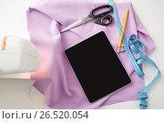 Купить «sewing machine, tablet pc, scissors and ruler», фото № 26520054, снято 29 сентября 2016 г. (c) Syda Productions / Фотобанк Лори