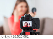 Купить «woman with eyebrow pencil recording video at home», фото № 26520082, снято 22 декабря 2016 г. (c) Syda Productions / Фотобанк Лори