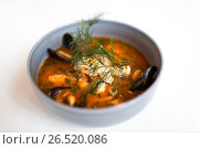 Купить «seafood soup with fish and blue mussels in bowl», фото № 26520086, снято 16 января 2017 г. (c) Syda Productions / Фотобанк Лори