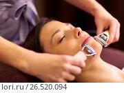 Купить «woman having hydradermie facial treatment in spa», фото № 26520094, снято 26 января 2017 г. (c) Syda Productions / Фотобанк Лори