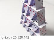 Купить «house of playing cards over white background», фото № 26520142, снято 15 марта 2017 г. (c) Syda Productions / Фотобанк Лори