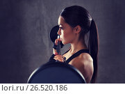 Купить «young woman flexing muscles with barbell in gym», фото № 26520186, снято 12 декабря 2015 г. (c) Syda Productions / Фотобанк Лори