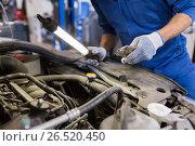 mechanic man with pliers repairing car at workshop, фото № 26520450, снято 1 июля 2016 г. (c) Syda Productions / Фотобанк Лори