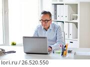 businessman in eyeglasses with laptop office, фото № 26520550, снято 16 декабря 2016 г. (c) Syda Productions / Фотобанк Лори