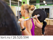Купить «woman with barbell at group training in gym», фото № 26520594, снято 19 февраля 2017 г. (c) Syda Productions / Фотобанк Лори