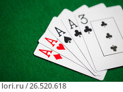 Купить «poker hand of playing cards on green casino cloth», фото № 26520618, снято 15 марта 2017 г. (c) Syda Productions / Фотобанк Лори