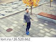 Купить «man exercising with jump-rope outdoors», фото № 26520662, снято 17 октября 2015 г. (c) Syda Productions / Фотобанк Лори