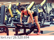 Купить «young woman flexing muscles with dumbbell in gym», фото № 26520694, снято 12 декабря 2015 г. (c) Syda Productions / Фотобанк Лори