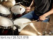 Купить «male musician playing drums and cymbals at concert», фото № 26521018, снято 18 августа 2016 г. (c) Syda Productions / Фотобанк Лори
