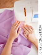 Купить «tailor woman with sewing machine stitching fabric», фото № 26521034, снято 29 сентября 2016 г. (c) Syda Productions / Фотобанк Лори