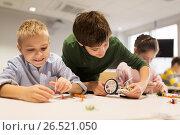 happy children building robots at robotics school. Стоковое фото, фотограф Syda Productions / Фотобанк Лори